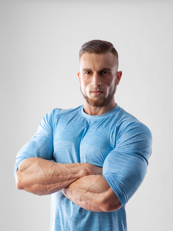 Portrait of a muscular male model on white background