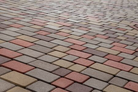 Photo of multi-colored paving stones pattern and background Imagens