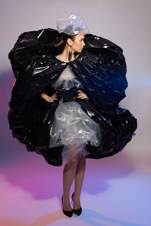 Girl posing in a dress made of plastic film. Fashion portrait. Reklamní fotografie