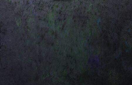 Abstract dark artistic background of a canvas covered with strokes of oil paint.