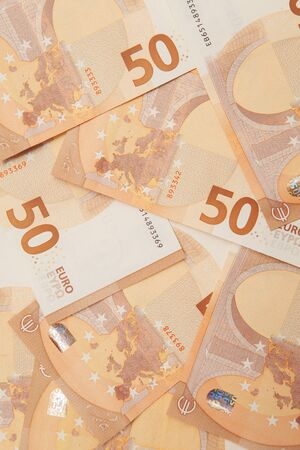 Background from banknotes of 50 euros, top view.