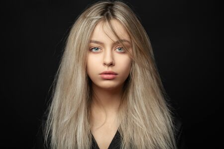 Beautiful young blonde girl with tousled hair Stock Photo