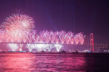 Fireworks over Istanbul Bosphorus during Turkish Republic Day celebrations. 15th July Martyrs Bridge (July 15th Sehitler Koprusu). Istanbul Turkey.