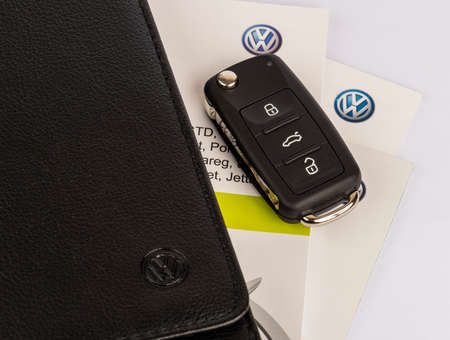 ISTANBUL, TURKEY - JANUARY 27, 2021: Volkswagen Owners Manual Guide Book and key.