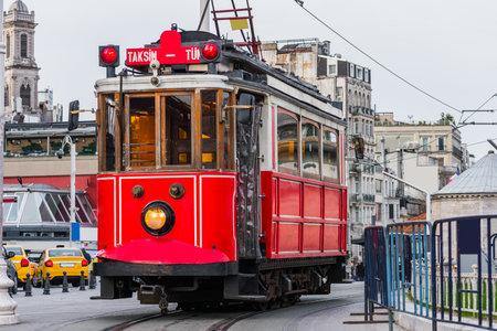 Nostalgic red tram in Taksim Square. Istiklal Street is a popular touristic destination in Istanbul, Turkey. Standard-Bild