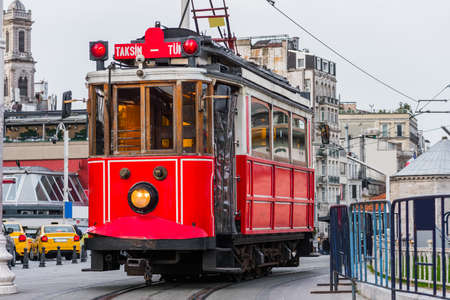 Nostalgic red tram in Taksim Square. Istiklal Street is a popular touristic destination in Istanbul, Turkey. Stock Photo