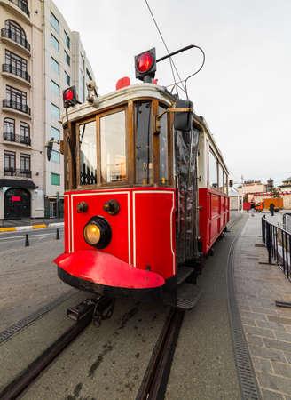 Nostalgic red tram in Taksim Square. Istiklal Street is a popular touristic destination in Istanbul, Turkey.
