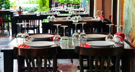 Luxury table settings for fine dining with and glassware. Beautiful blurred background. Wine glasses and plate on table.