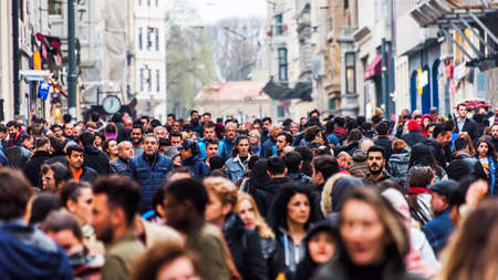 ISTANBUL, TURKEY - APRIL 1, 2019: Crowd of people on Istiklal Caddesi, Taksim. Touristic popular destination Taksim Istiklal Street. Beyoglu, Istanbul, Turkey.