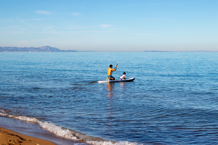 doing paddle surfing in family with a small child