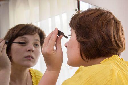 mirror: woman in cosmetic mirror