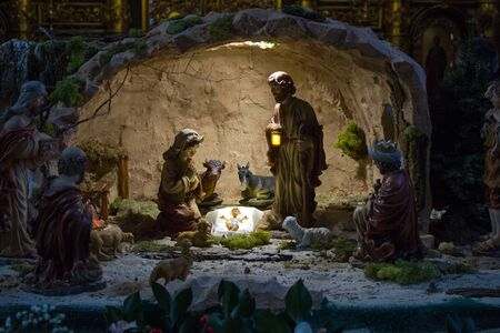 birth of jesus: Christmas Manger scene with figurines including Jesus, Mary, Joseph, sheep and magi.
