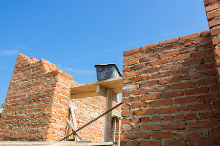 sand lime bricks: new construction brick building of brick against the sky Stock Photo