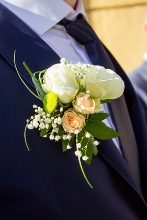 flowers boy: groom boutonniere on a costume of a profile Stock Photo