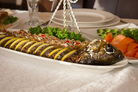 stuffed fish: Stuffed fish with salad on the table  a restaurant Stock Photo