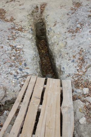 land slide: long pit dug on the road is dangerous