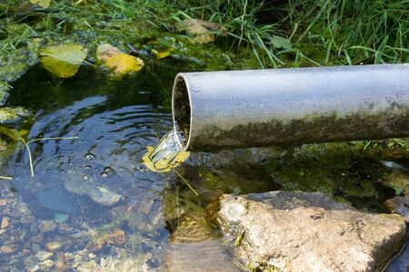 castings: crystal-clear water flows from the pipe in the feed