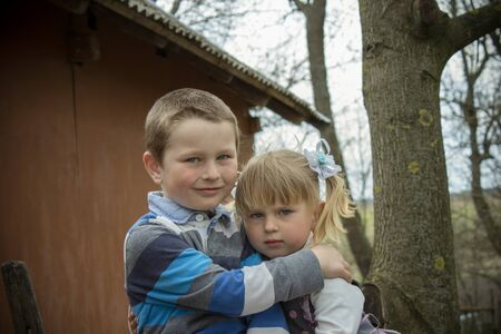 love hug: Portrait sitting hugging brother and Setra in rural areas