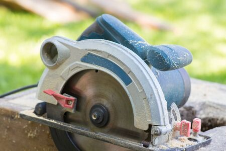 electric tools: Circular saw electric tools with wood shavings Stock Photo