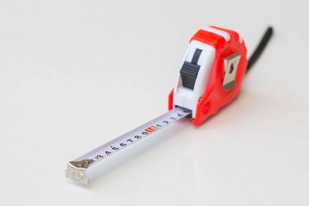 Tape measure tool red on a white background