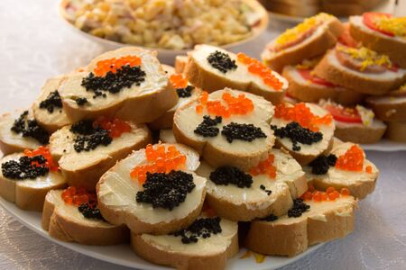 sandwich with black and red caviar on the table