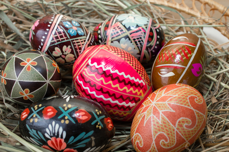 Ukrainian Easter Eggs on hay Фото со стока