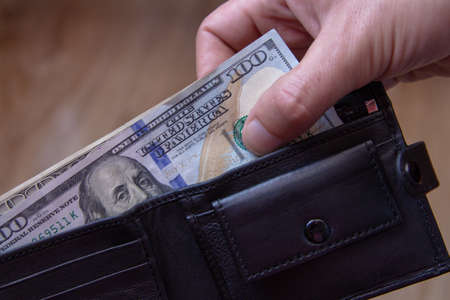 take dollars from your wallet,payment in cash from a mans wallet