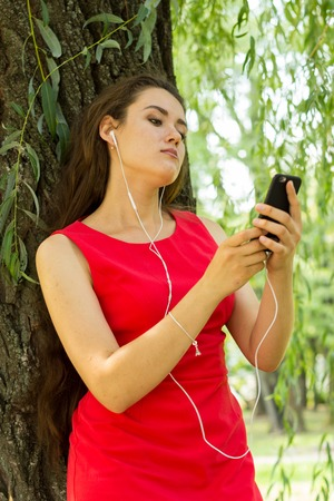 Young woman listening music on the street Stock Photo