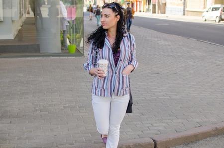 paso de cebra: girl crossing the street on the empty crosswalk