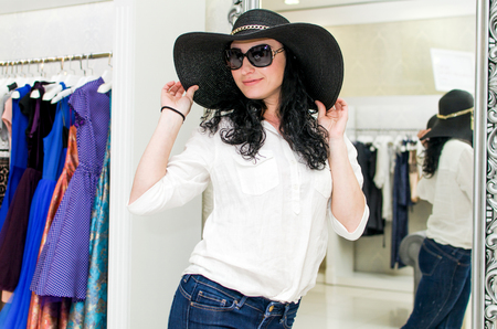 woman wearing hat: Young Woman wearing hat in the clothing store