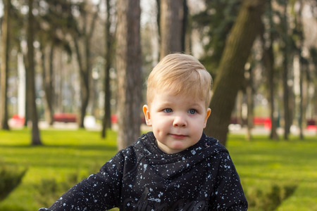 dimple: Close-up photo of little boy with a dimple on his cheek Stock Photo