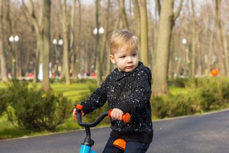 eyebrow raised: Little boy with a raised eyebrow on the run bike