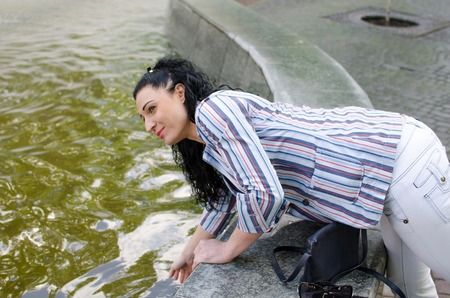 beauty fountain: Young girl resting at fountain