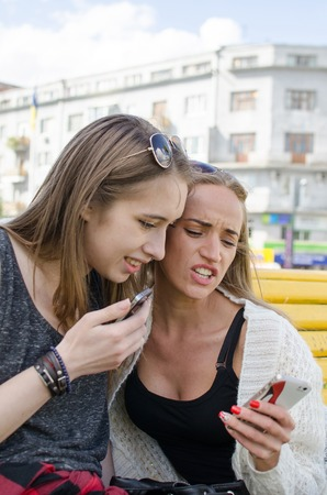 telephones: Two girlfiends with the telephones on the street Stock Photo
