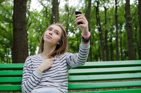 Young girl making selfie with her cell phone