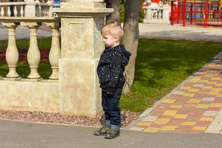 pout: Little boy pout in the park Stock Photo