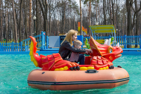 dragon swim: Mother and son riding the red dragon attraction