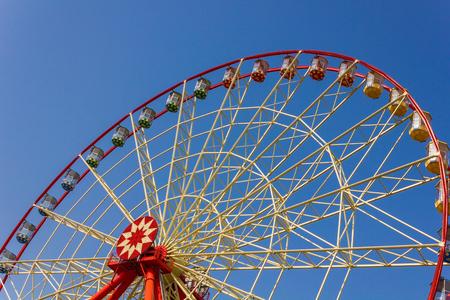ferriswheel: Red ferris wheel in the blue sky