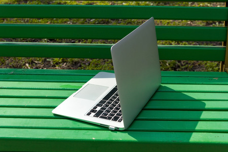 netbooks: Silver laptop on the green bench