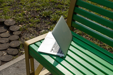 Silver laptop on the bench