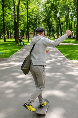 Young man with skateboard in the park Stock Photo