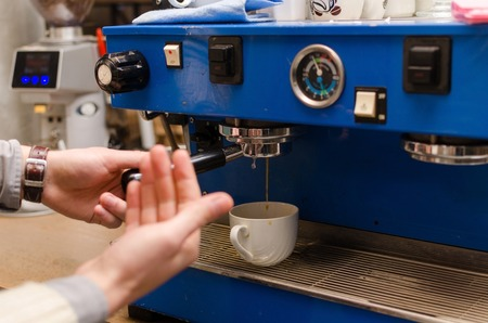 Close-up photo of making coffee in cafe