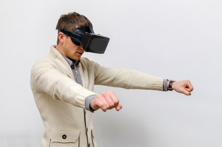 Man in virtual glasses imagining himself a biker Stock Photo