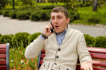 tree service business: Young man is arguing with someone on the phone