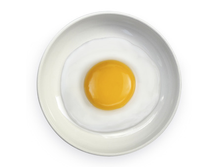 fried egg with on the plate a white background Stock Photo