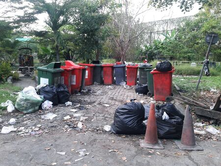 Plastic trashcan With garbage in garden public park