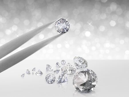 Diamond in tweezers on white shining bokeh background. concept for chossing best diamond gem design