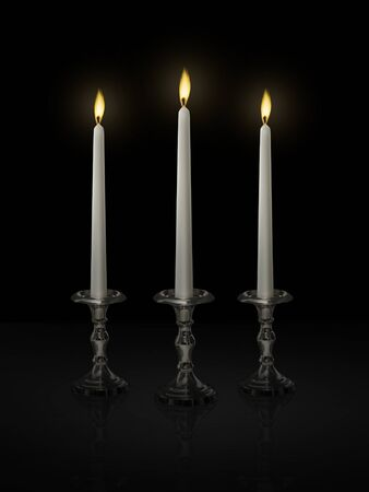 Candle light on a candlestick on a black background Фото со стока - 150183971