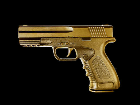gun gold metal isolated on black background