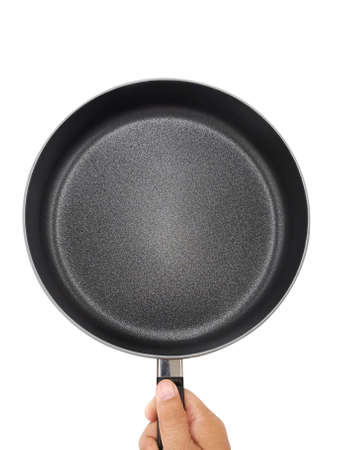 Male's hand holds frying pan. Isolated on white. Top view
